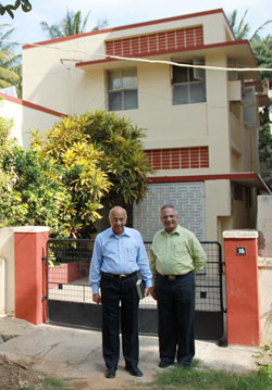 Zac Poonen and Ian Robson in front of 16 DaCosta Square